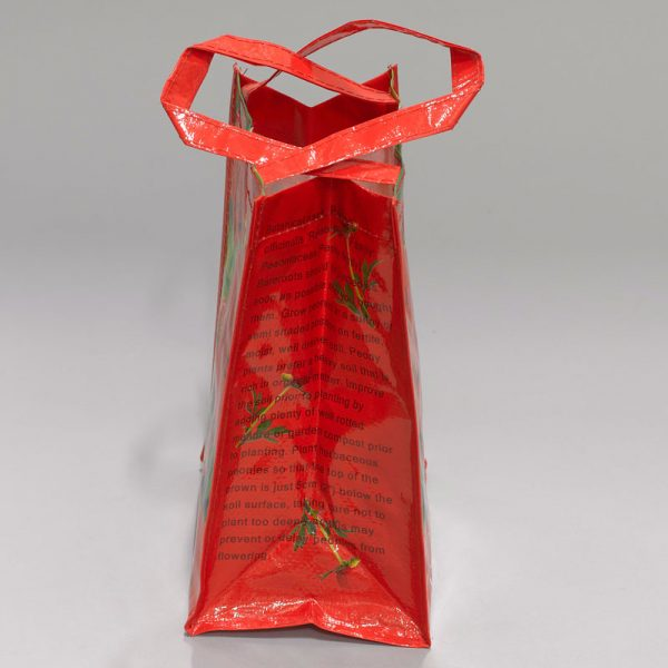 tas met pioenroos rood zijkant